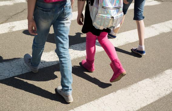Children walking across a crosswalk