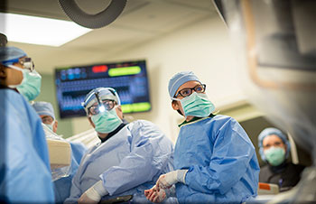 Doctors performing the TAVR procedure