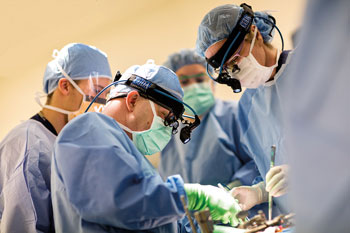 Surgeons performing a procedure