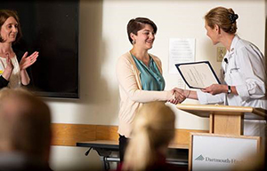 Nurse receiving an award