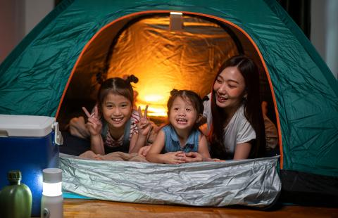 Asian family camping inside