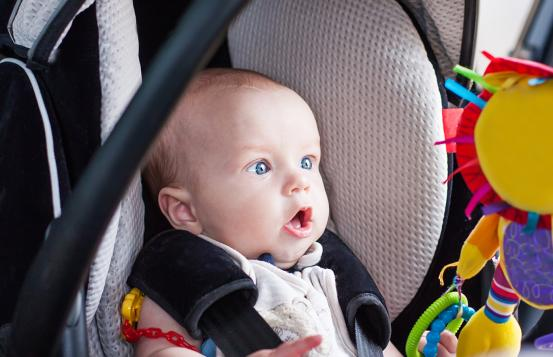 Baby in a car seat.