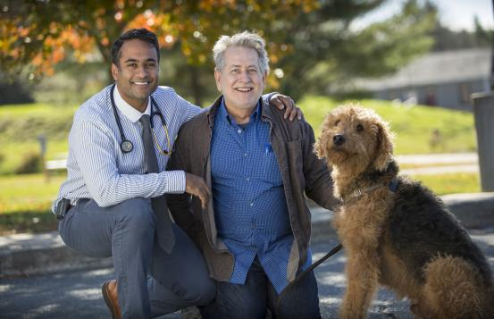 Dr. Kapadia with Dick Poulin and his dog