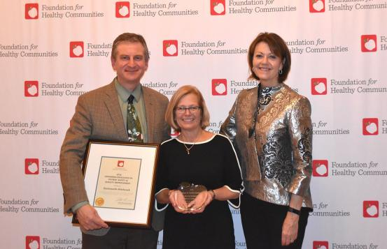 Group photo of award recipients: Chief Quality and Value Officer George Blike, MD; Director of Quality and Safety Lori Key, MBA, RN; and CEO and President Joanne Conroy, MD.