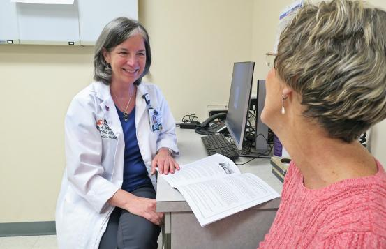 Susan Distasio speaking with a patient.