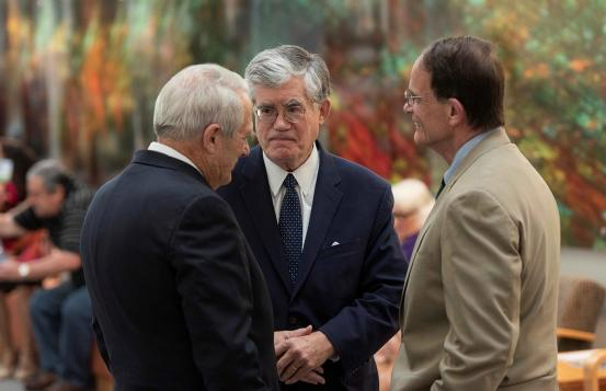 Former chief justice and senior director of external affairs at D-H, John Broderick chats with Vermont Supreme Court Chief Justice Paul Reiber, and New Hampshire Supreme Court Chief Justice Robert Lynn