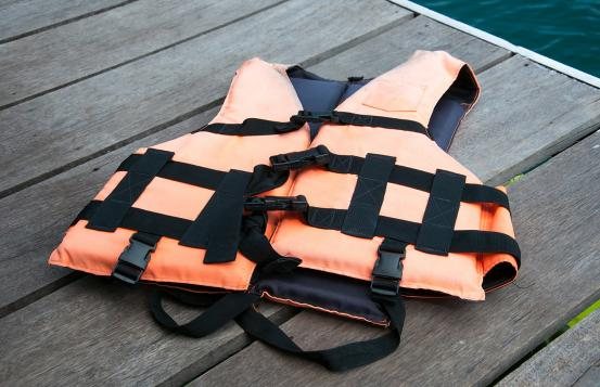 Orange life jacket on a dock.