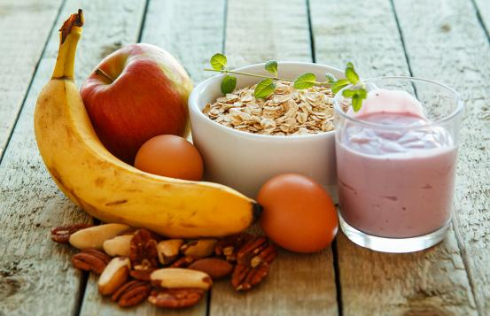 Healthy breakfast options, banana, apple, nuts, oats and yogurt