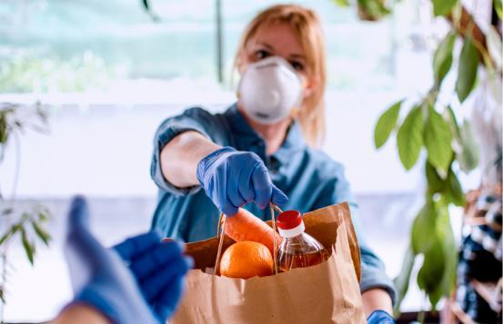 Women handing over bag of food