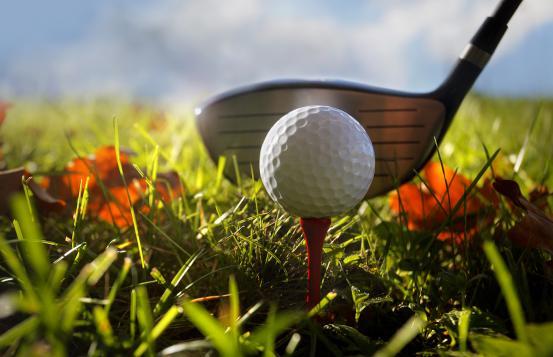 golf club, golf tee and golf ball on fall background