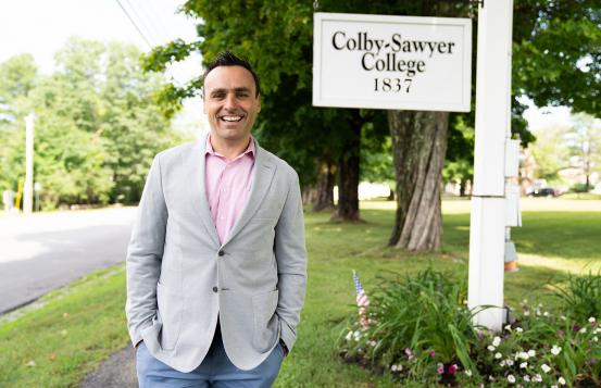 Kevin Finn in front of the Colby-Sawyer College sign