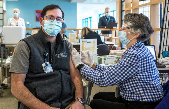 Michael Calderwood receiving COVID-19 vaccine