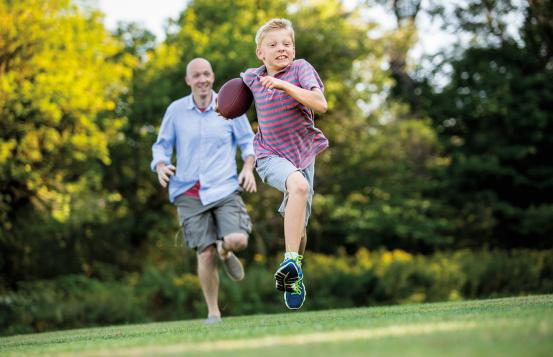 Jack Deliso playing football with his dad.