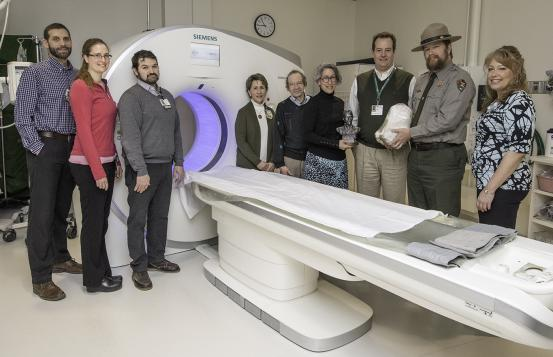 Employees of Dartmouth-Hitchcock and Marsh-Billings-Rockefeller National Historical Park pose with a CT scan machine.