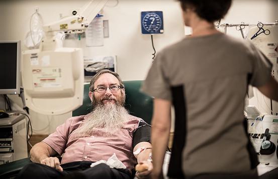 Dean Peel donates blood