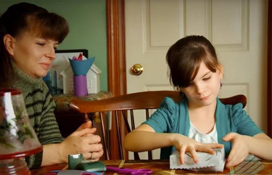 Lauren sitting with her mother