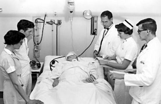 Doctors, nurses, and a patient