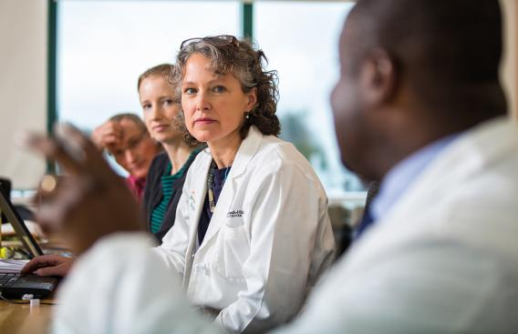 Dartmouth-Hitchcock physicians listening to a speaker.
