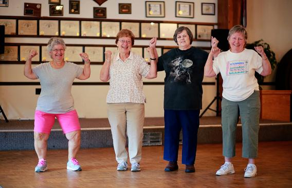 Edwina exercising with other seniors