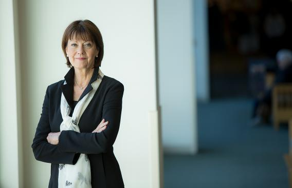 Portrait of Dr. Joanne Conroy in DHMC hallway.