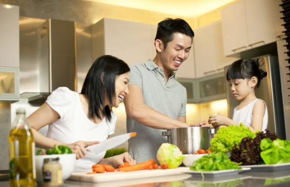 A family cooking together.