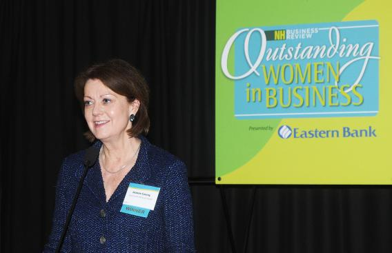 Joanne M. Conroy, MD, accepts NH Business Review Outstanding Women Leader award.