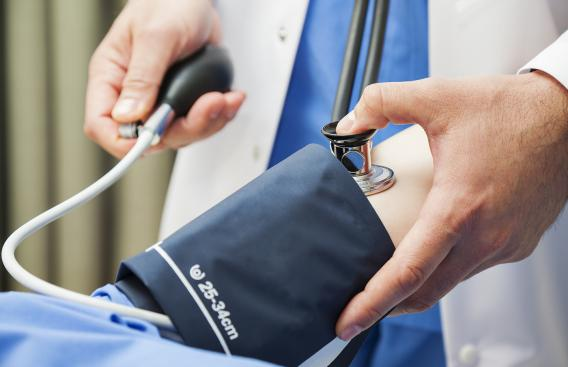 doctor using a blood pressure cuff