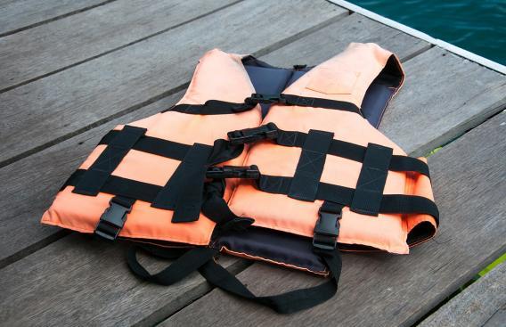 Orange life jacket on a dock.