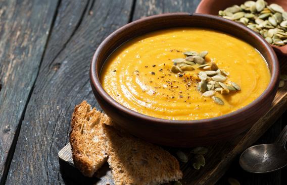 Bowl of pumpkin soup with pumpkin seeds