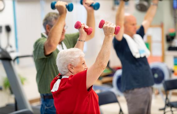 Cardiac Rehab participants lifting weights
