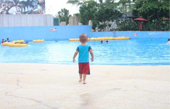 Child approaching water with no life vest on.