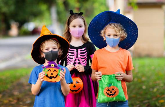 Kids in masks trick-or-treating