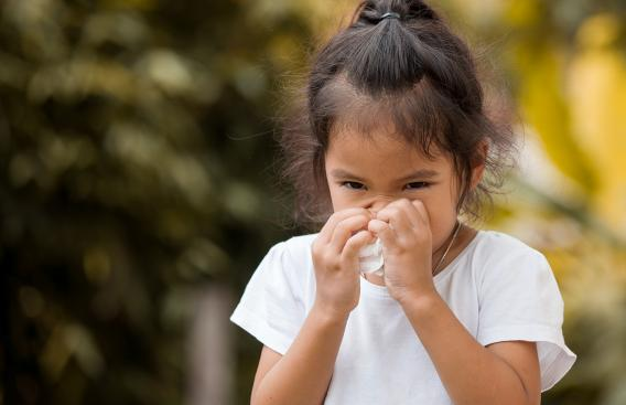 Child with a facial tissue