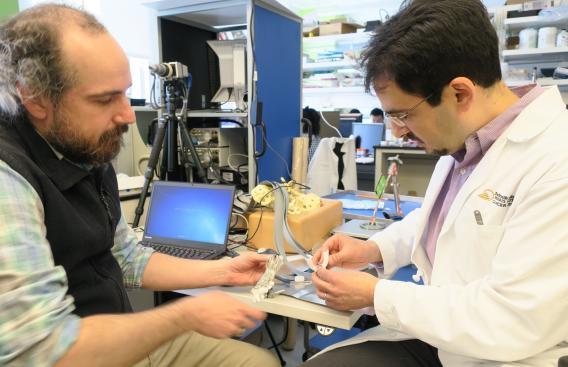 Research scientists Ryan Halter, PhD, and Joseph Paydarfar, MD