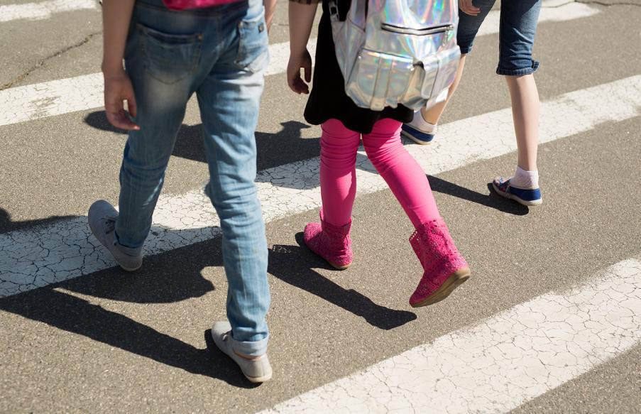 Children walking across a crosswalk