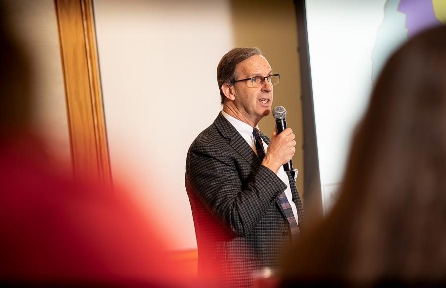 Dr. Will Torrey speaking at public forum.