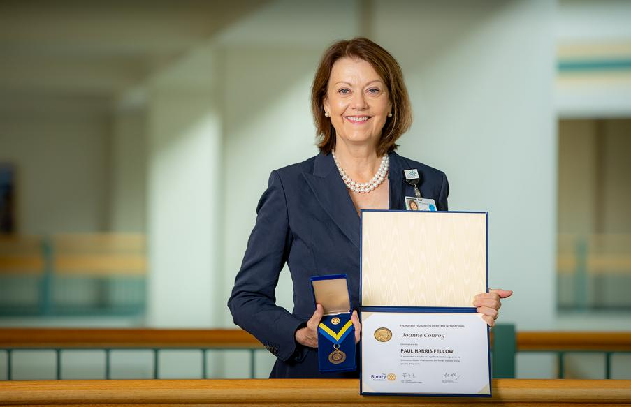 Joanne M. Conory, MD, with Paul Harris Fellowship documents